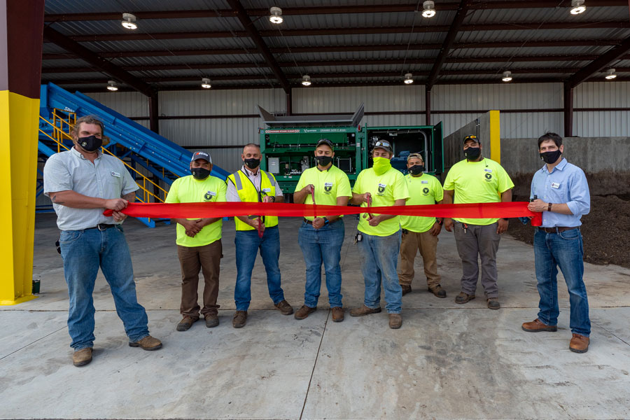 Denton Baldwin, Founder of Freestate Farms (left) and Doug Ross, CEO (right) celebrate the ribbon cutting of the new composting system.