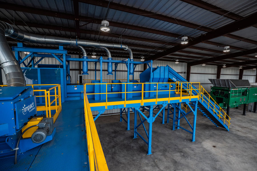 The picking line is a crucial step in the process to remove contaminants prior to composting.