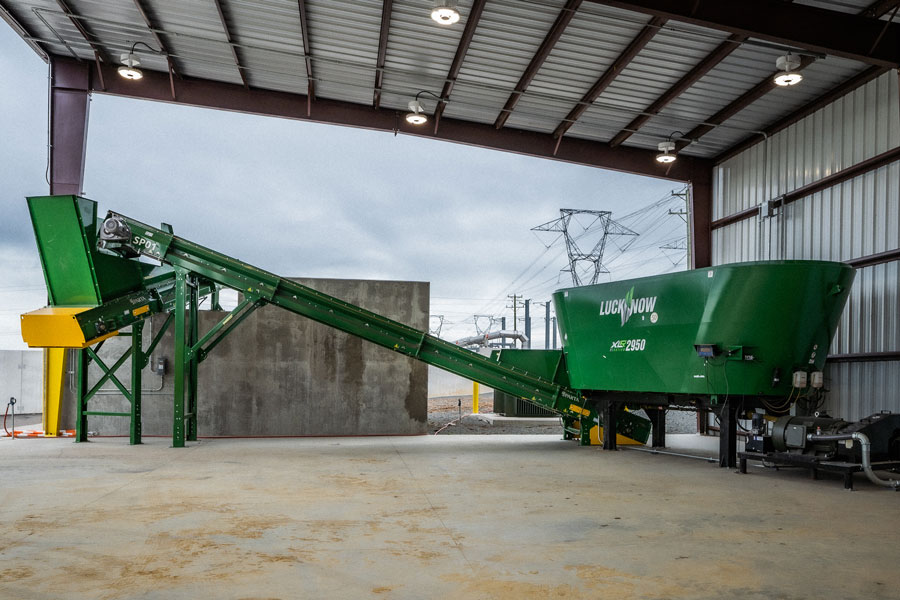 The mixing machine further blends and optimizes the pre-shredded and pre-sorted feedstock prior to composting.